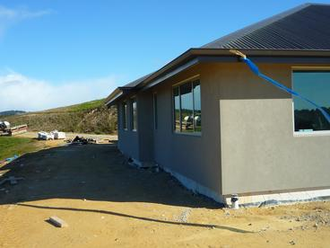 Stucco cladding over AAC concrete panel and cedar features (08.08.2014)